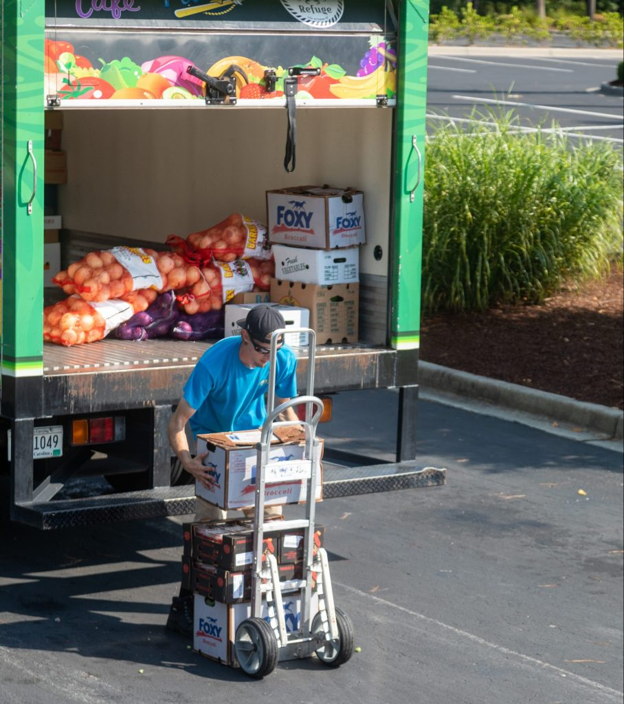 A&A employee loading cart for commercial kitchen